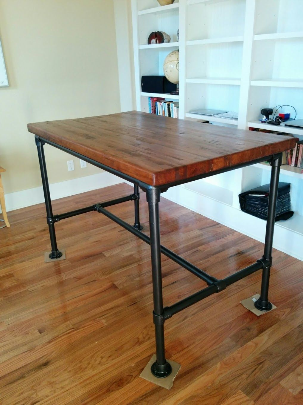My home office/study work desk made from reclaimed railroad car flooring and a http://www.simplifiedbuilding.com/ desk frame kit painted oil rubbed broze