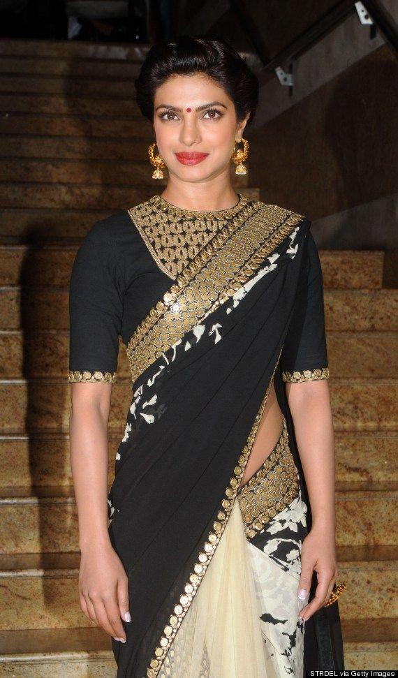 816d4f1638e43 Priyanka Chopra Goes Bollywood Glam In Black And Gold Saree (PHOTOS ...
