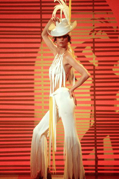 Cher poses in a Bob Mackie outfit.