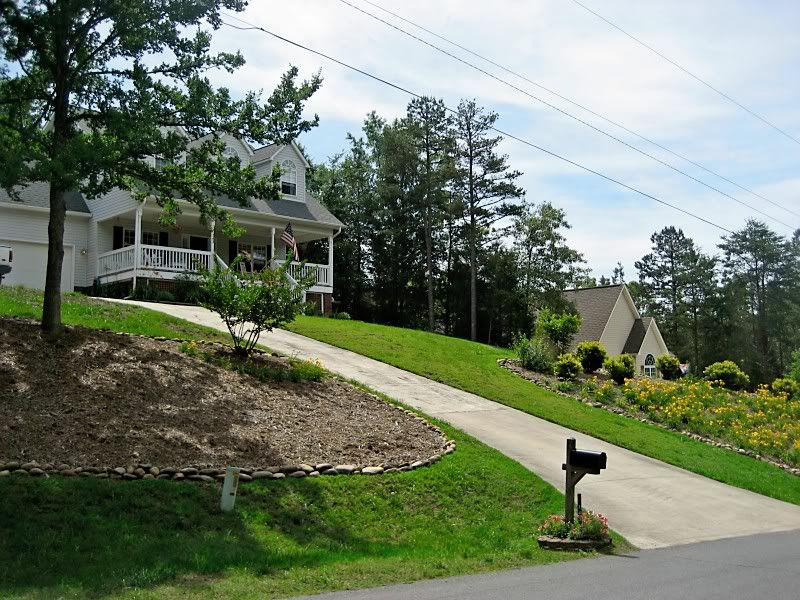 Driveway ideas up a hill google search house ideas for Sloped driveway options