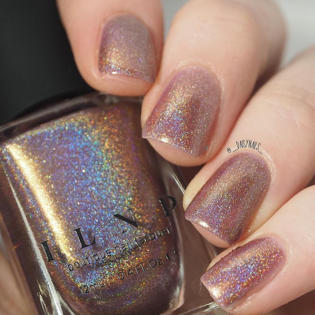 A little bit of a different shot but this is @ilnpbrand 'champagne blush' which I got for my birthday way back in January! I believe it was bought from @rainbow_c_uk #rcuk  I love this polish so much! It's a champagne holo polish   I am in the process of editing a swatch video so that should be up the next few days! by _daisynails_