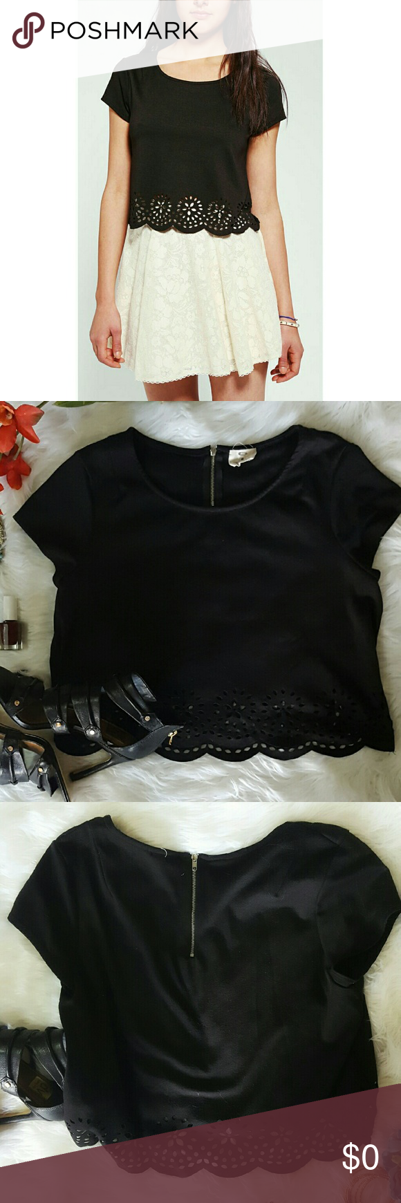"""UO Lasercut Crop Urban outfitters crop top in excellent pre-owned condition. Pins and Needles brand. Exposed zipper in back.  Size Medium. Bust: 17"""". Length: 17.5"""". Poly/rayon/spandex. Handwash.  No PP, Merc, Trades or Holds please  Suggested User/5-Star Seller   THANKS FOR VISITING! HAPPY POSHING! Urban Outfitters Tops"""