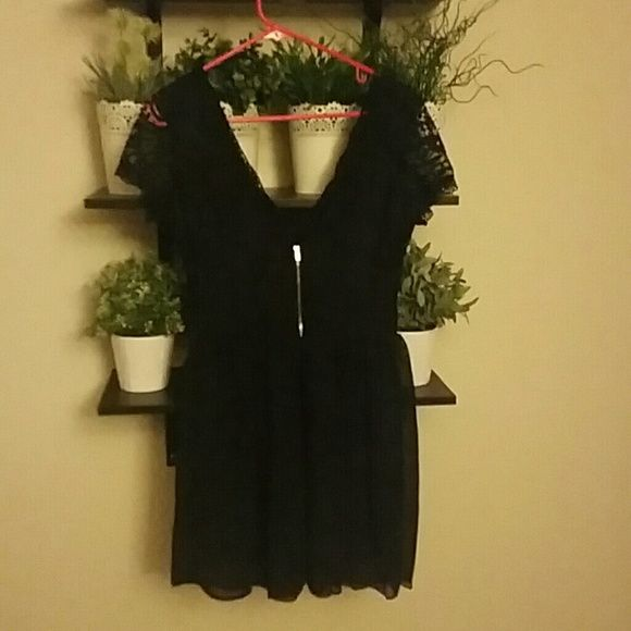 Never worn little black dress Never worn black dress with lace top and sheer bottom All Dresses Mini