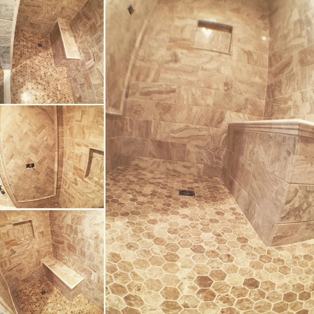 Walk in shower using a schluter system hexagon marble on the hexagon marble on the floor with coordinating tiles installed in a brick pattern on the walls mechanical wall has smaller tiles in a herringbone dailygadgetfo Gallery