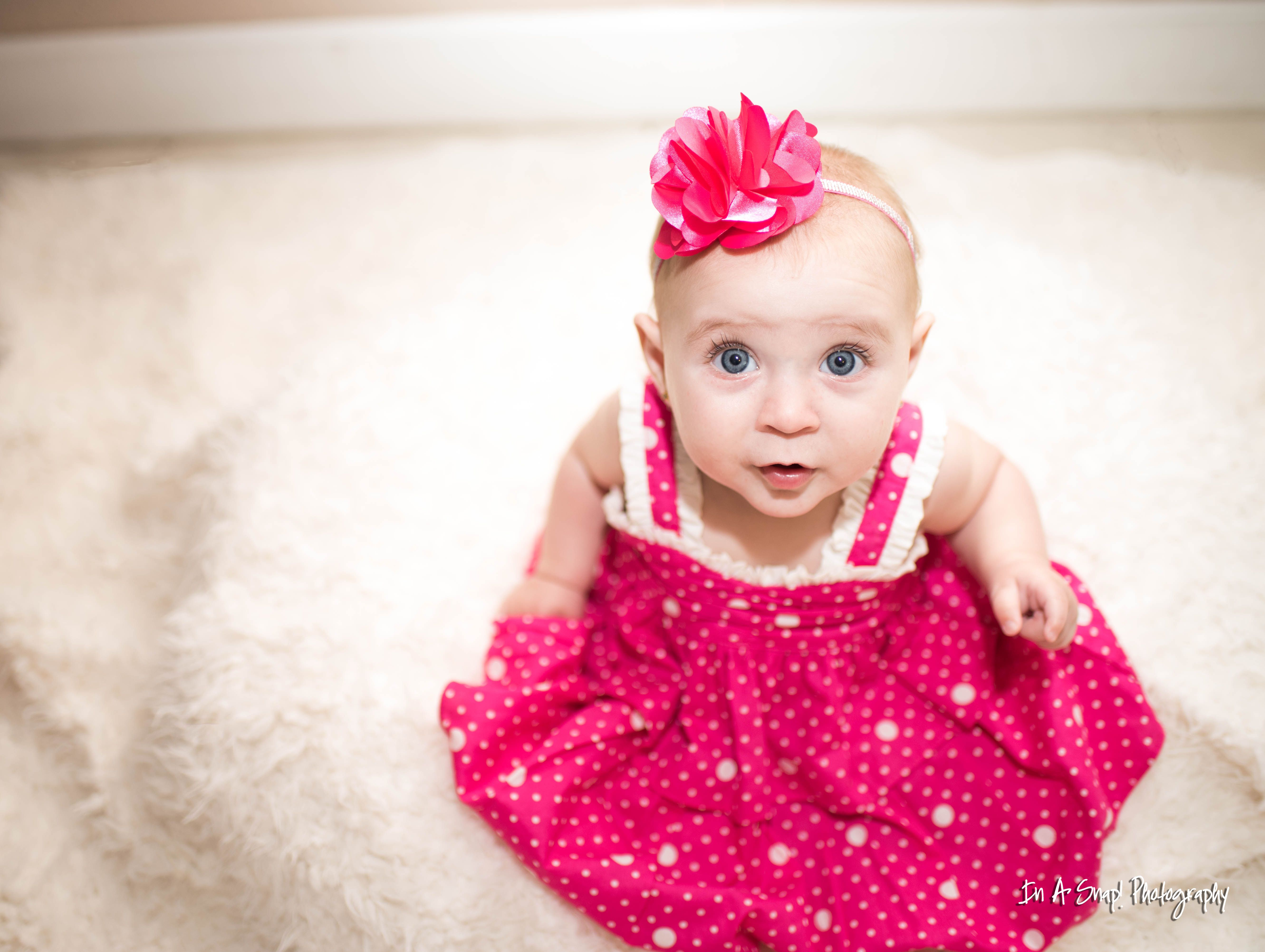 baby blue eyes so beautiful in her pink dress.