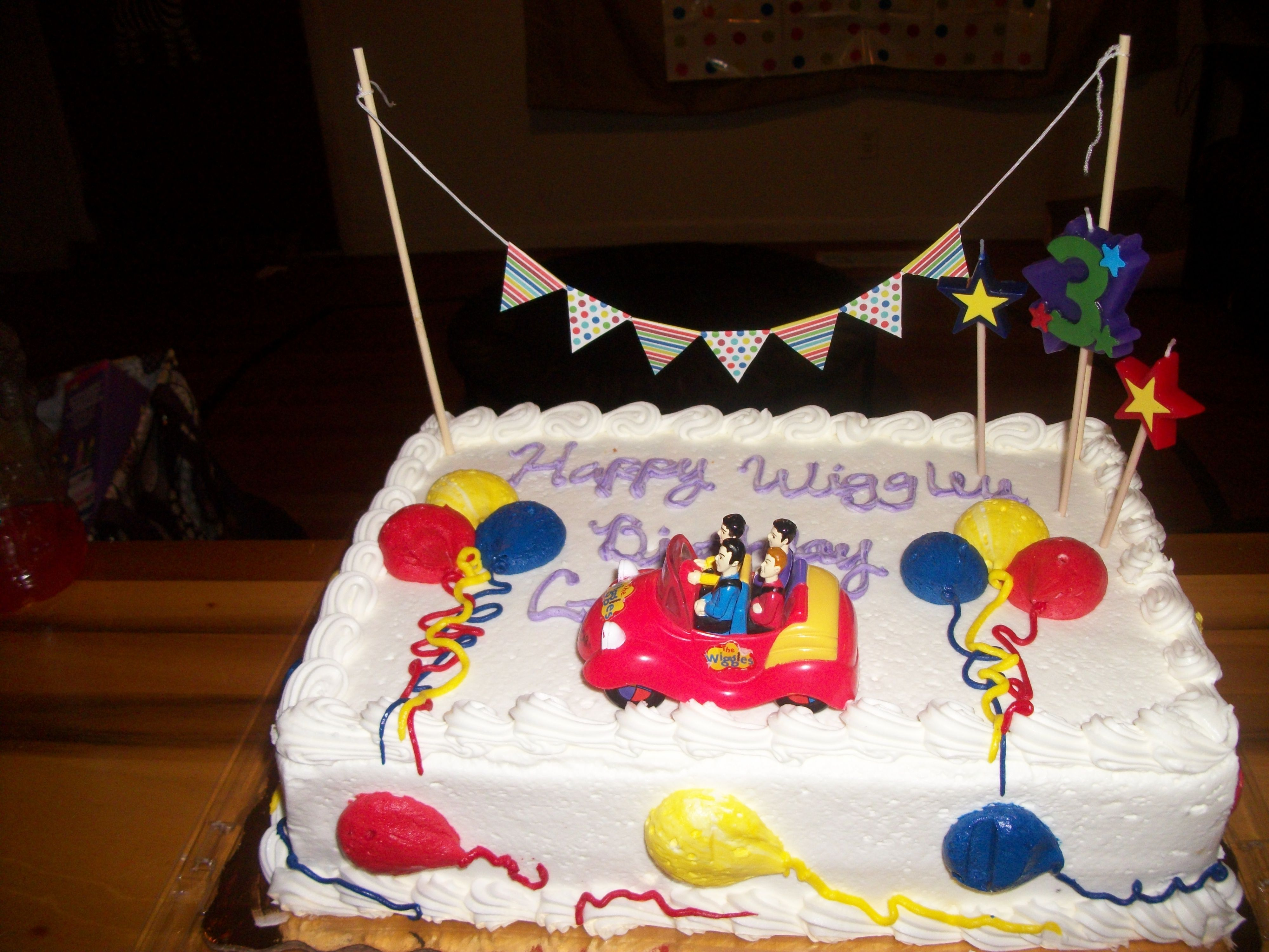 I Got A Sheet Cake At Publix Added Some Balloons And A Wiggles Toy Car My Son Had And A Banner From Target It Tur Wiggles Birthday Circus Birthday Circus Cakes