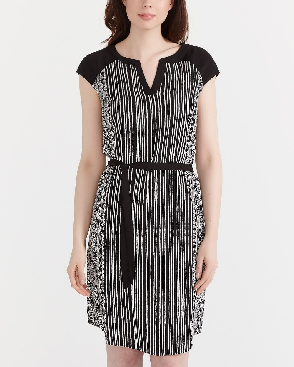 This short sleeve belted dress is made of rayon and polyester it