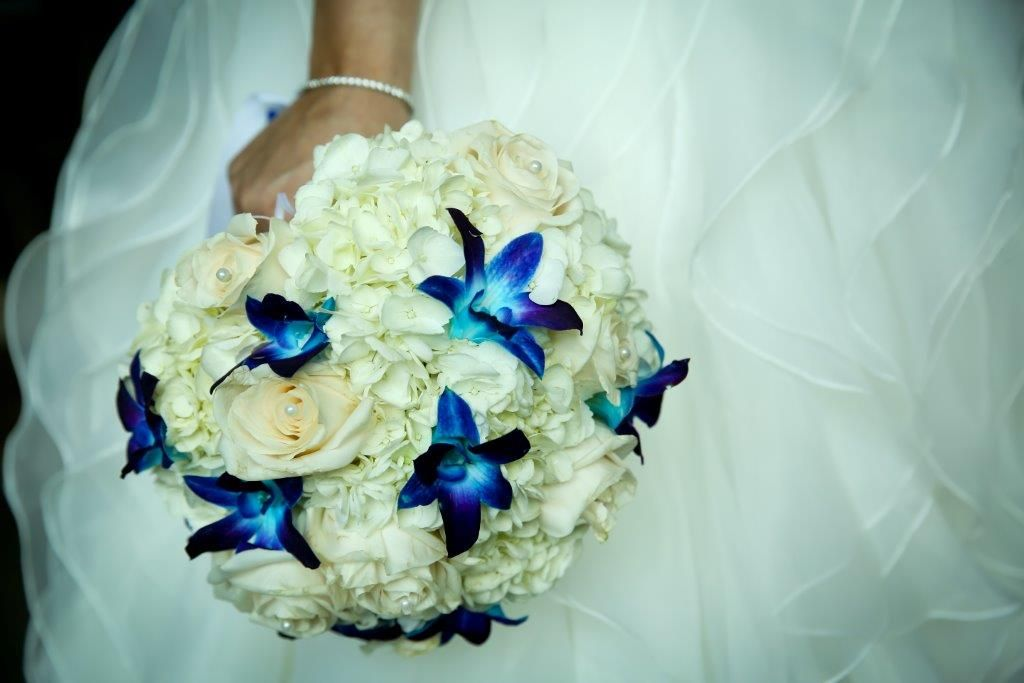 This gorgeous #bridalbouquet is dotted with blue dendrobium orchids; which is our most highly requested flower. http://weddingsinthebahamas.com/photo-gall…/bridal-bouquets/