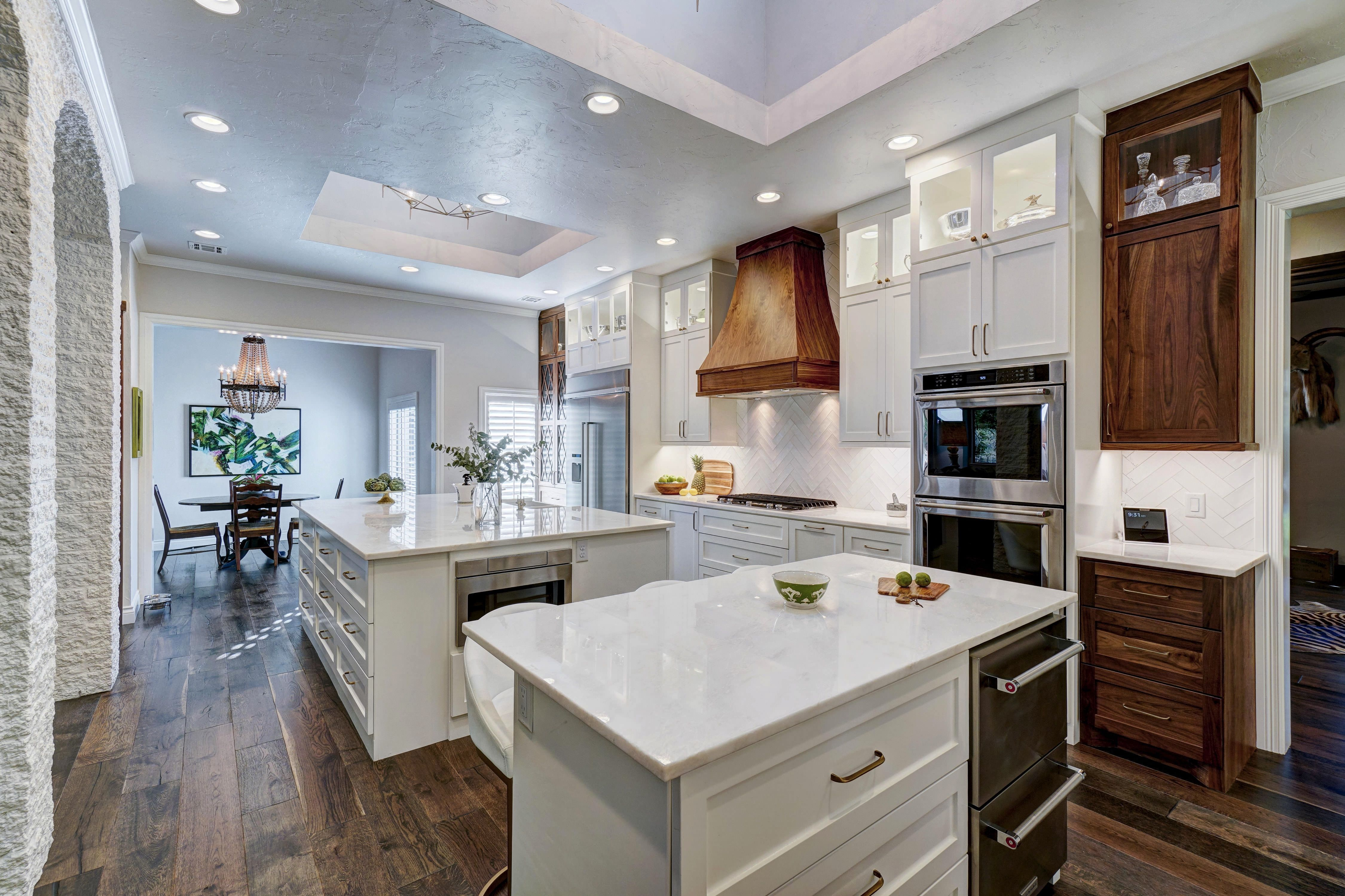 Beautiful kitchen with White and Walnut cabinets, two islands and ...