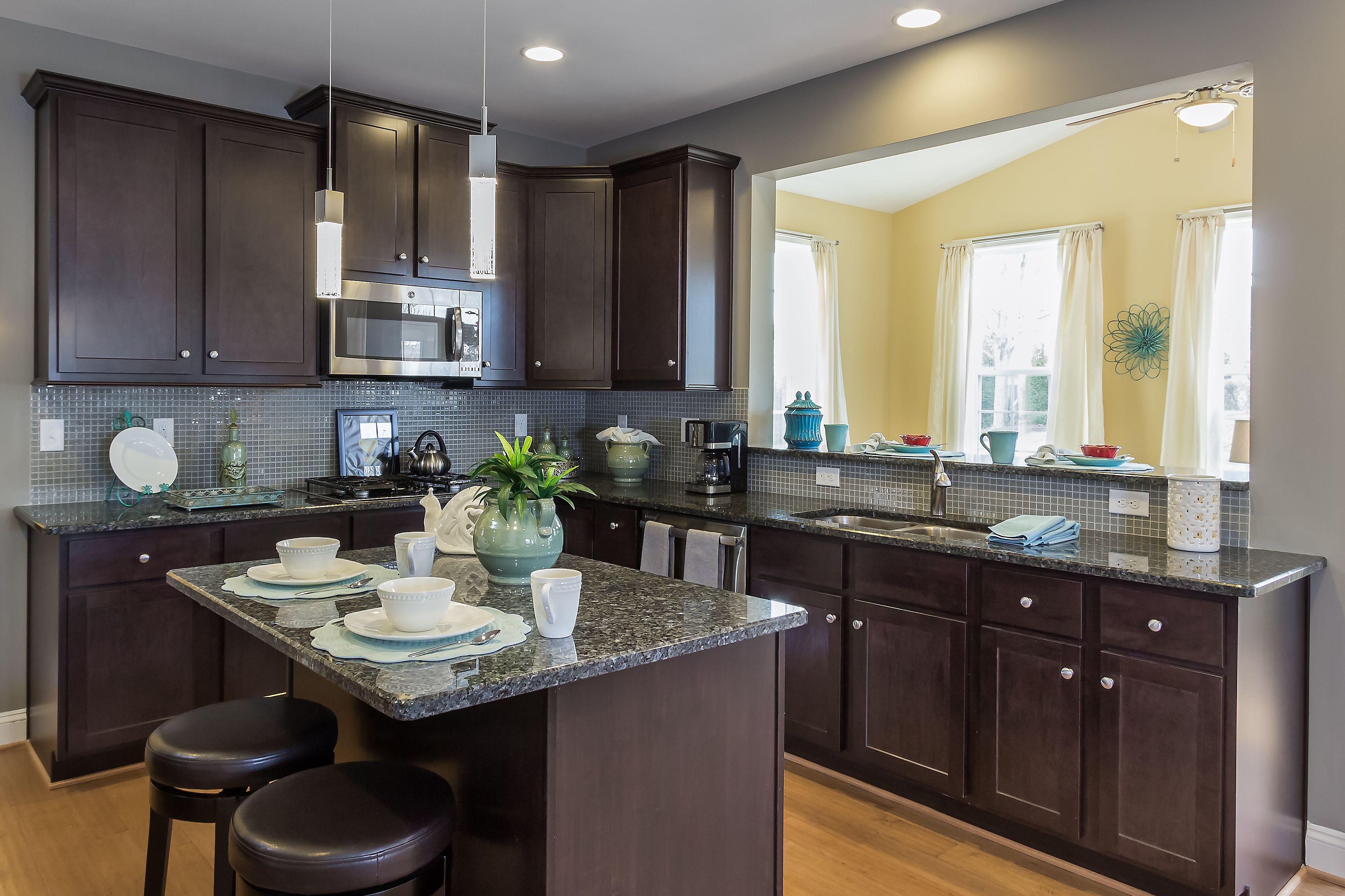 dark cabinets granite countertops breakfast area at the