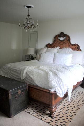 Neutral Master Bedroom vi Operation Pretty House  Antique chandelier, leopard rug, ornate headboard, white bedding, transitional decor  Operation Pretty House