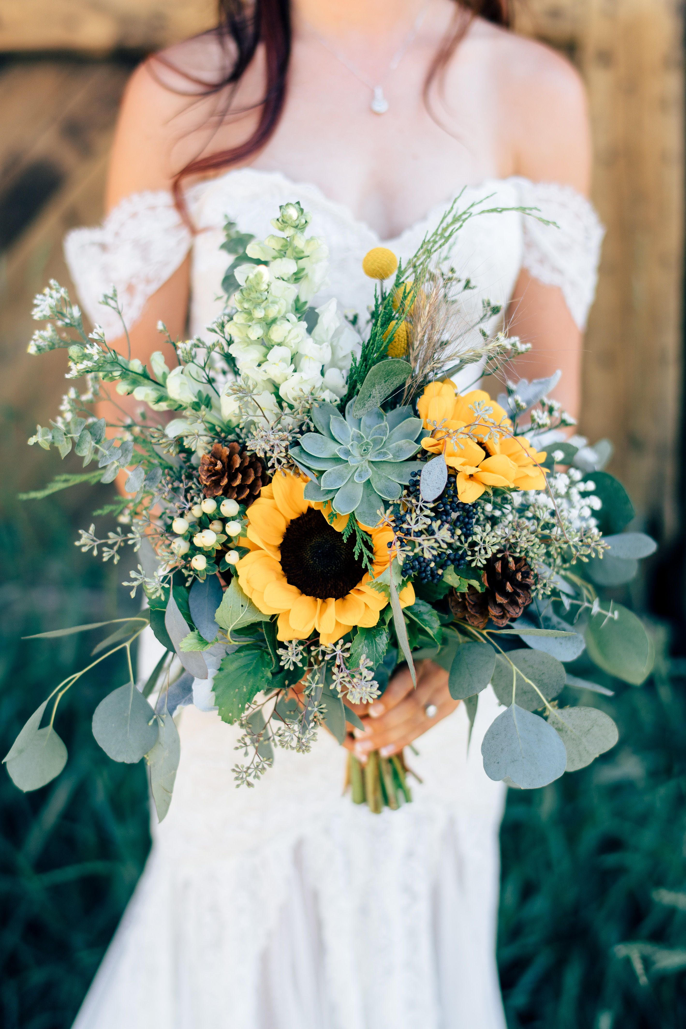20 Succulent Wedding Bouquets Perfect For The Boho Bride Sunflower Wedding Bouquet Wedding Flower Arrangements Wedding Bouquets