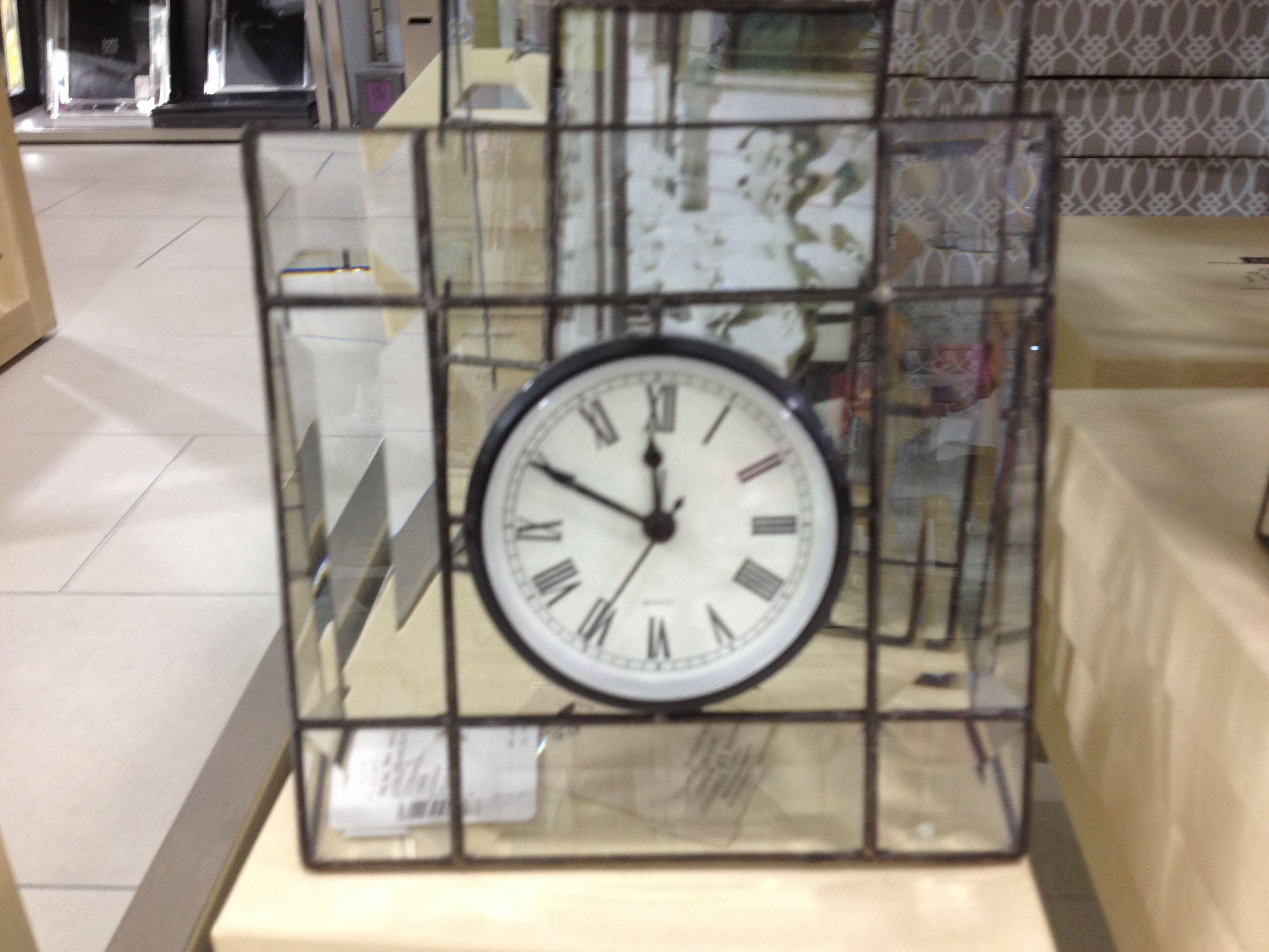 Clock in glass frame.
