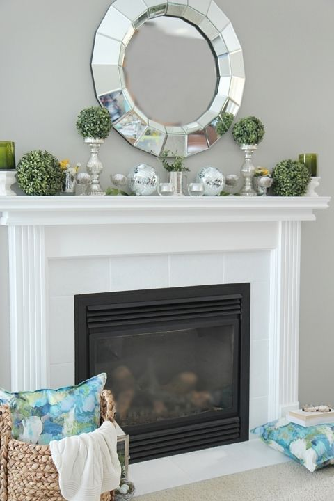 How to Decorate a Spring Mantel with Style. See my mantel filled with pretty Spring accents and color. www.settingforfour.com