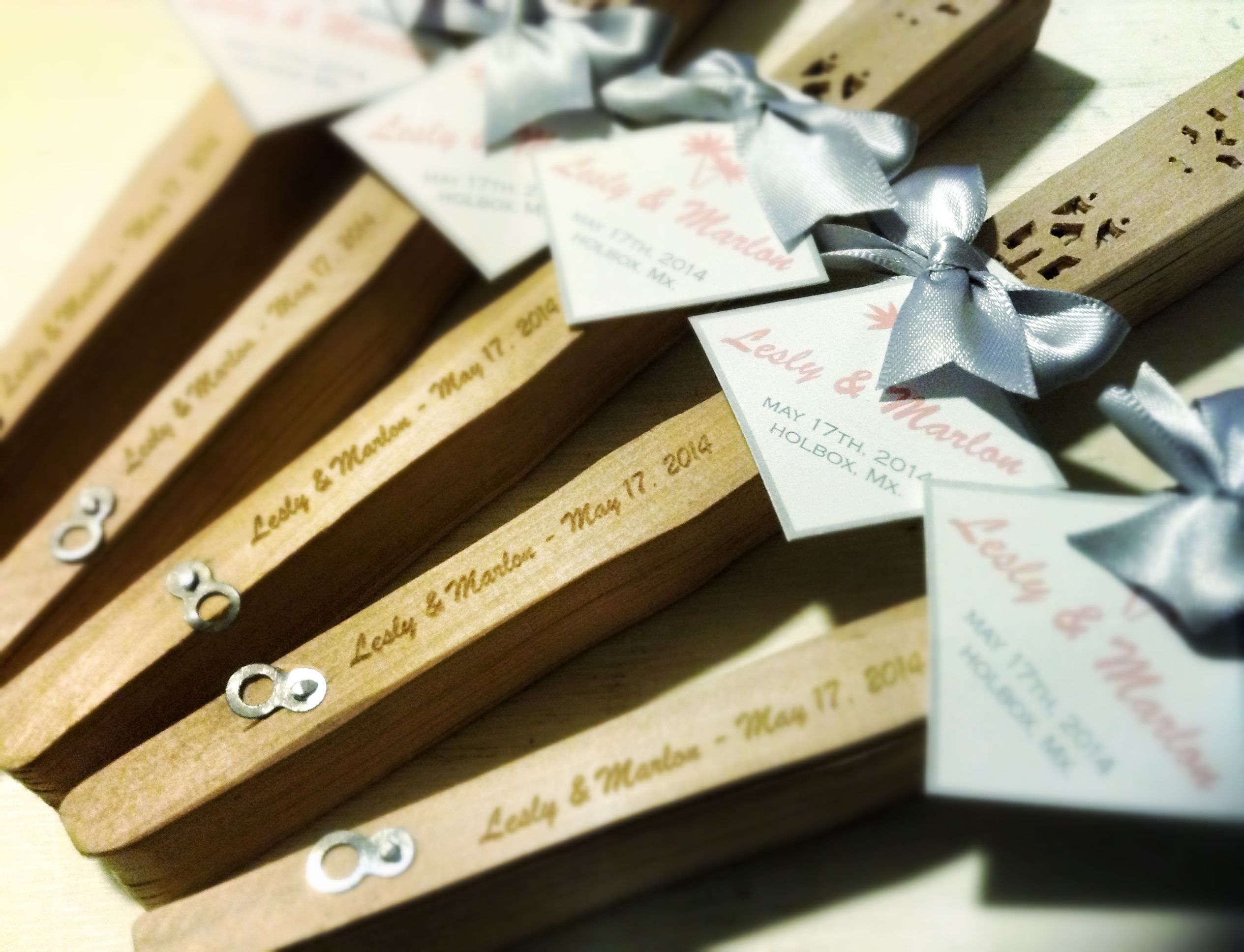 Beautiful engraved Wood fan favors for wedding in Holbox México