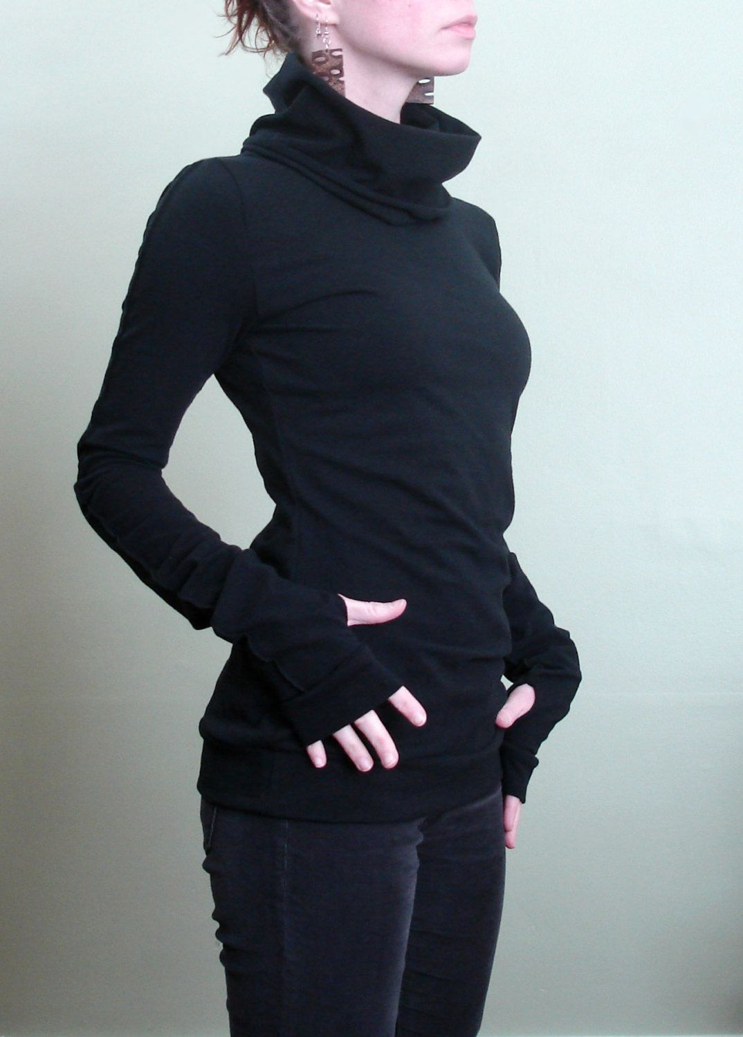 a4d4b9ac3 turtleneck cowl top with thumb hole sleeves in Black