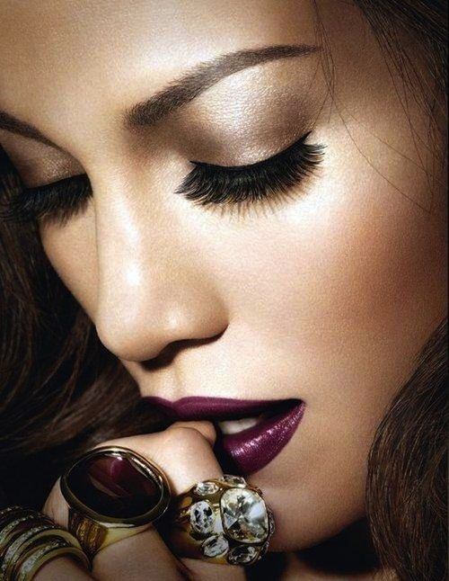 Plum lips with shimmery neutral eyes and golden undertones. Striking for all hair colours!