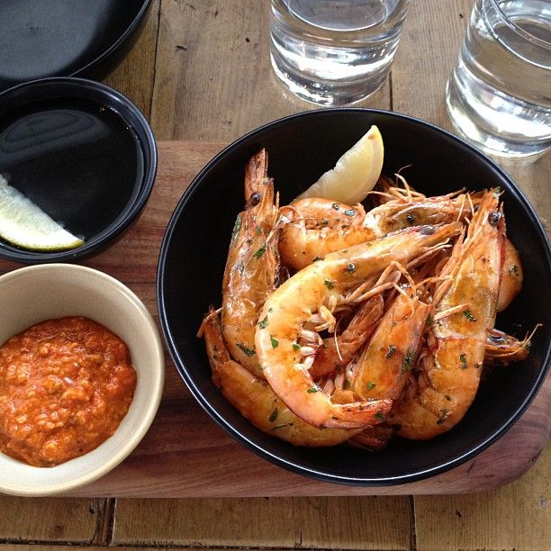 Bowl of grilled prawns with romesco
