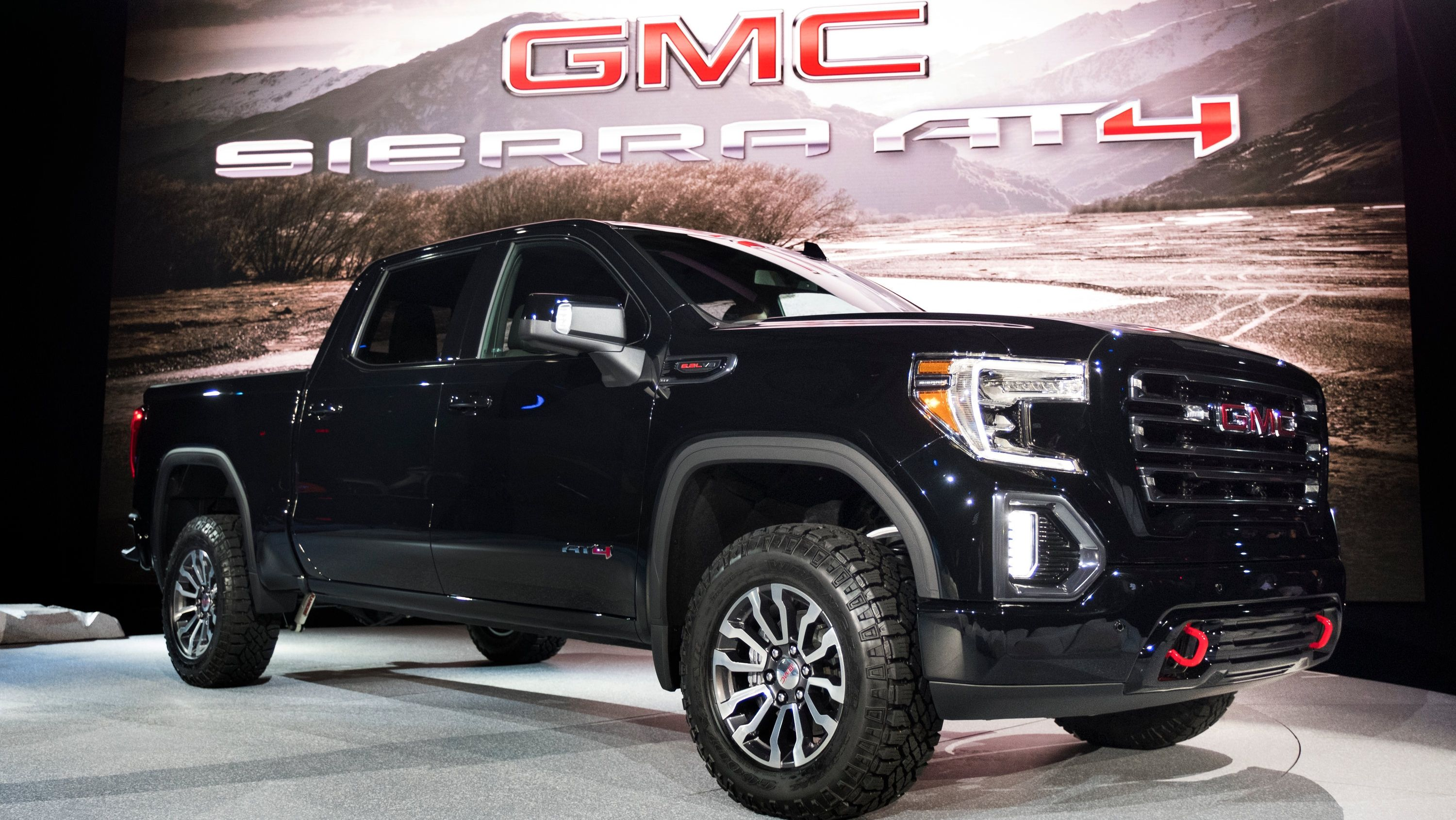 The Gmc Sierra At4 Is Here To Put The Hurt On The Ford F 150 Raptor Ram Power Wagon And The Toyota Tundra Trd Pro Top Speed Gmc Trucks New Trucks Gmc