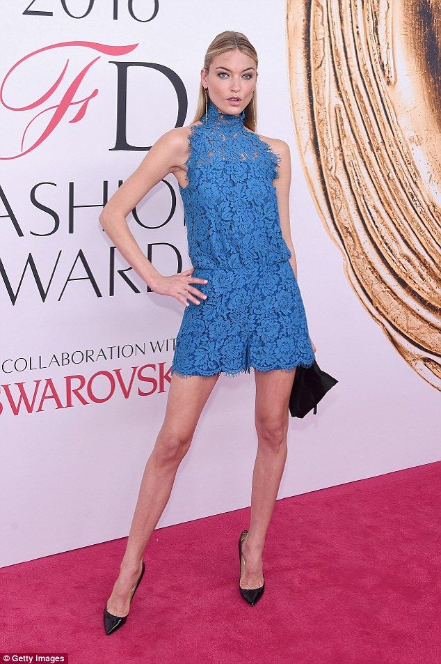 Work it! The Victoria's Secret model turned heads in her blue DVF jumpsuit on Monday evening at the CFDA Fashion Awards in New York. The periwinkle blue, flower-laced romper matched her piercing blue eyes