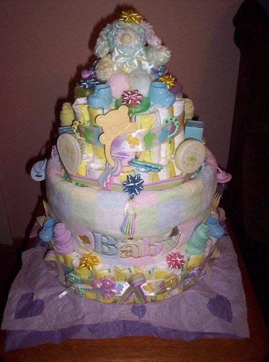 Pastel Diaper Cake with washcloth Roses and lots of goodies for Baby.