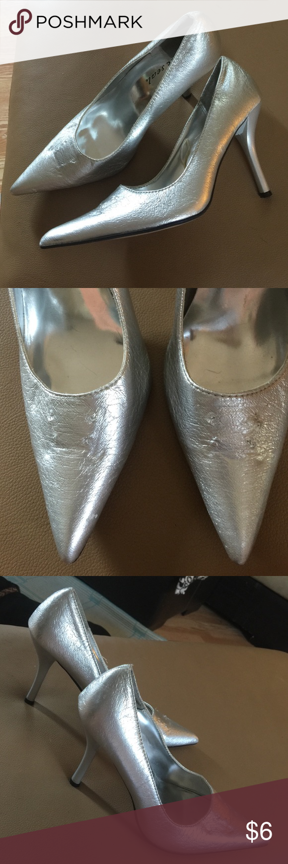 Wet Seal silver heels Basic pointed toe pump. Second pic shows small marks on front of shoe where rhinestones were removed. Needed solid shoe for photo shoot. Always considered attaching a shoe pin but never did. True size 7 Wet Seal Shoes Heels