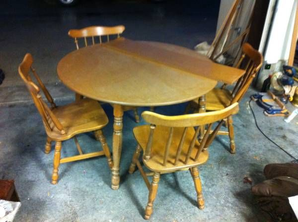 4 foot round table with 4 spindle chairs. http://seattle.craigslist.org/see/zip/4940340180.html