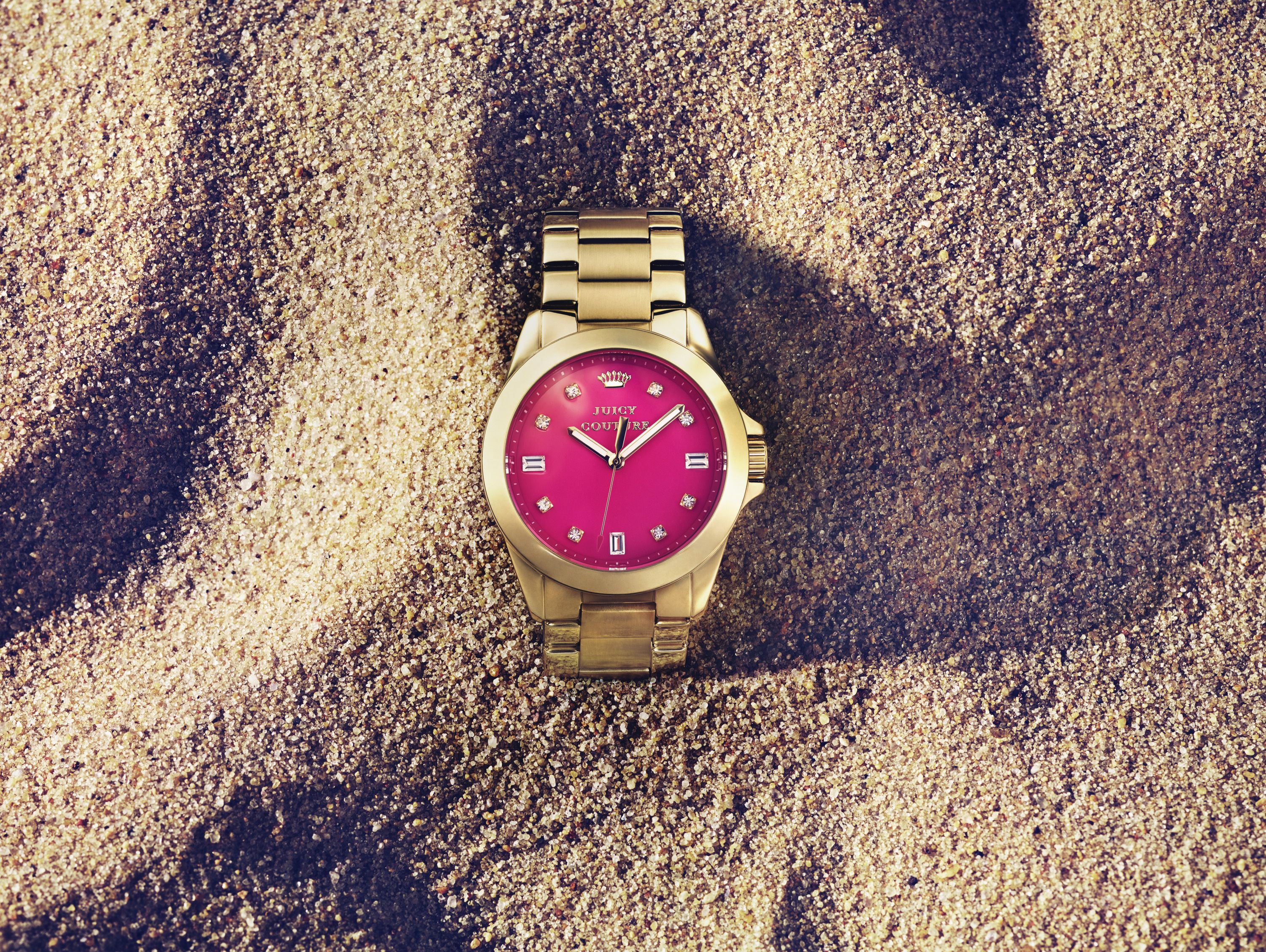 JuicyCouture timepiece with pink dial. Available at