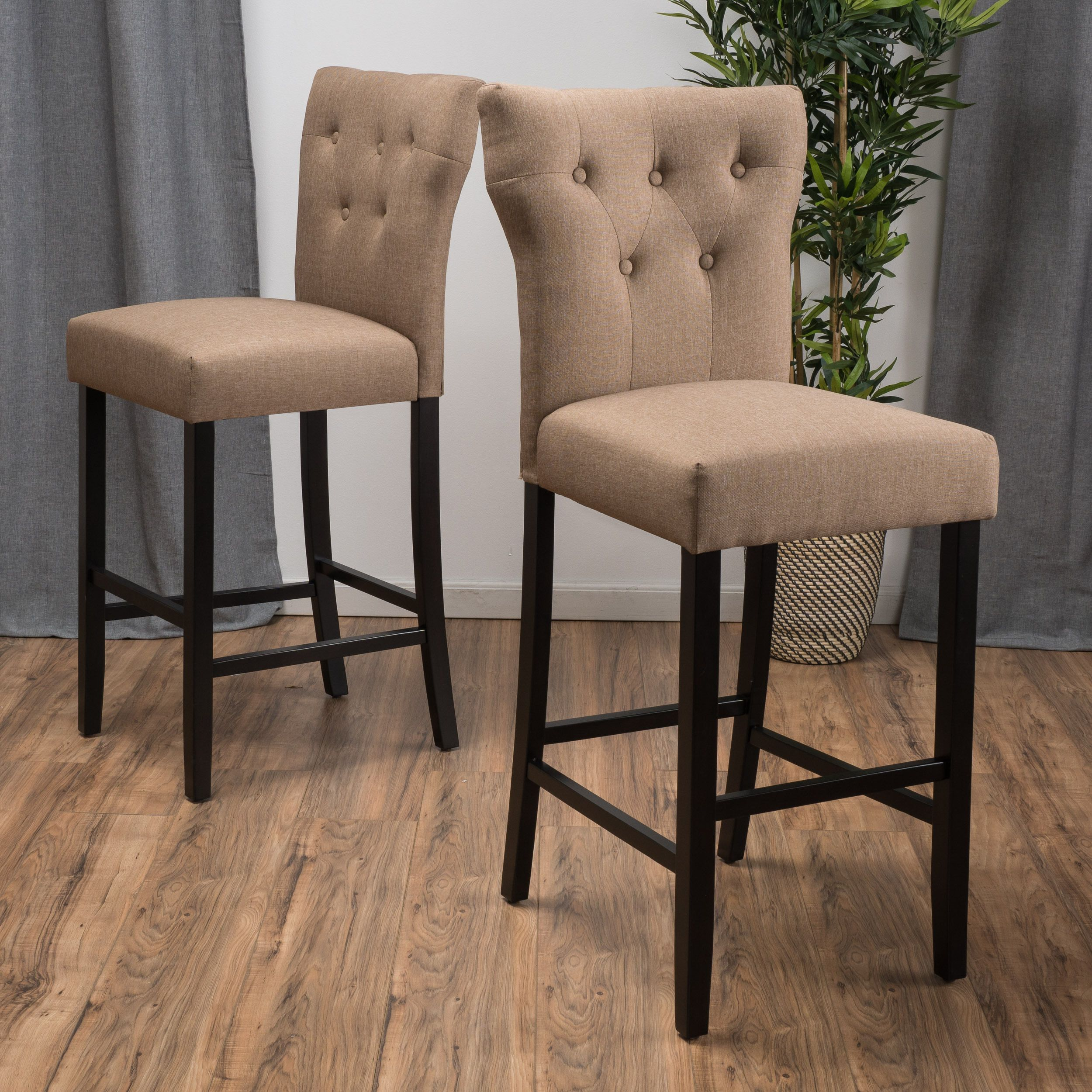 The Christopher Knight Home Donner counter stool is a stylish addition to any decor. Resting on sturdy rubberwood legs, the Donner counter stool offers enhanced stability and durability.