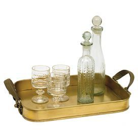 """Serve canapes or cocktails at your next soiree with this brass tray, showcasing leather handles for classic appeal.  Product: TrayConstruction Material: Brass and leatherColor: GoldFeatures: Two handlesDimensions: 4"""" H x 18"""" W x 13"""" D"""