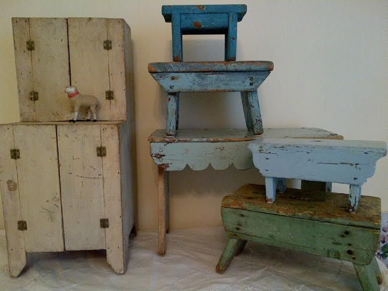 Wonderful assortment of primitive stools and fine example of a childs stepback cupboard in original oyster paint