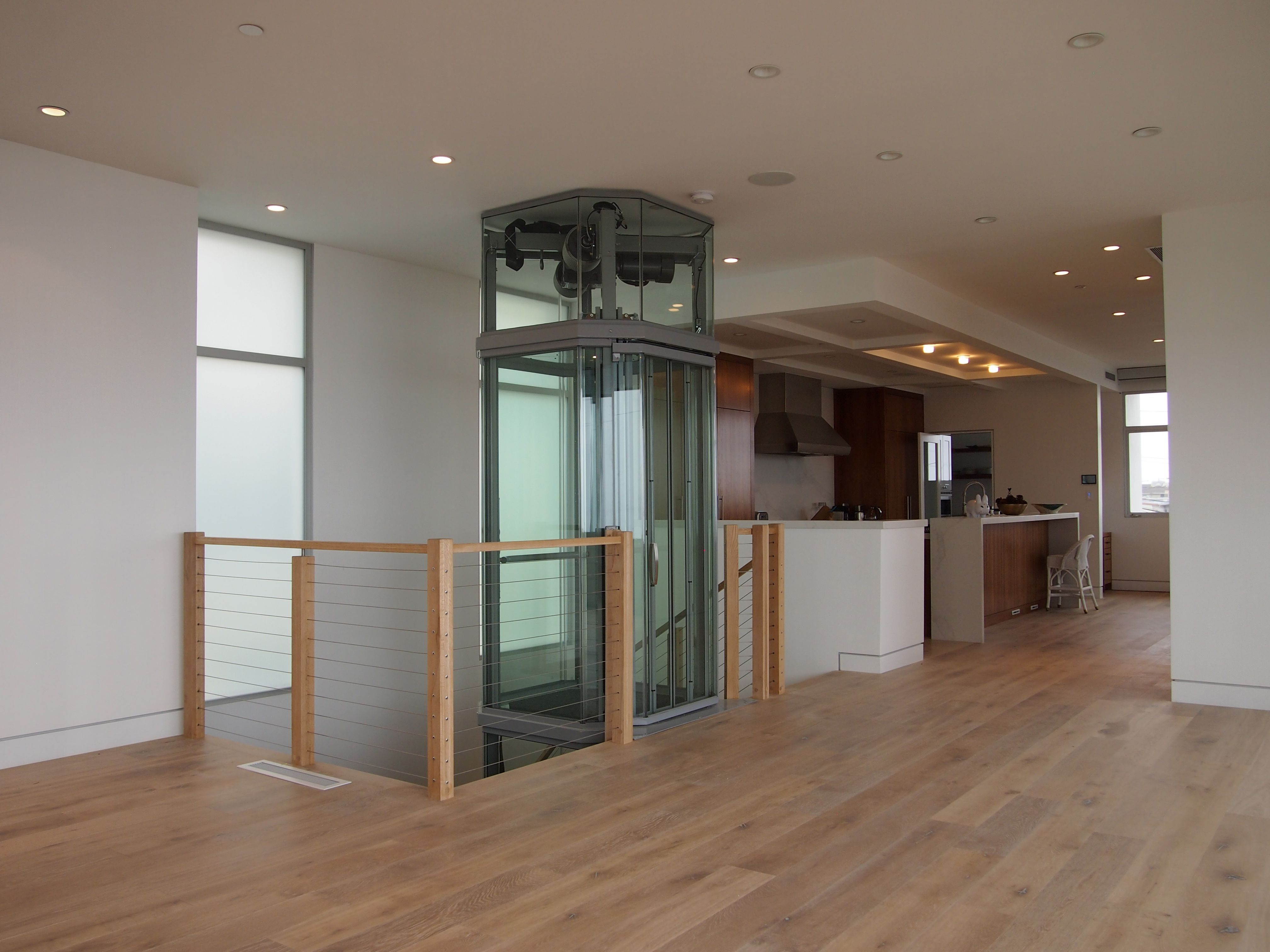 added accessibility never looked so good visilift glass glass octagonal elevator on landing with balcony attachment