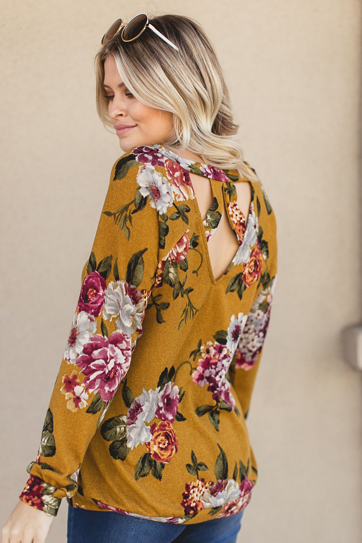 This mustard floral top is PERFECT to transition into spring