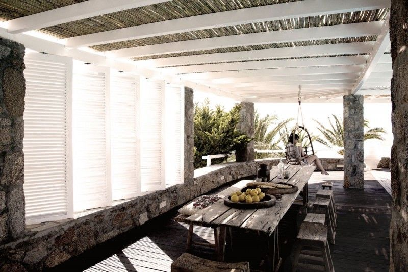 Black Colored Dining Table also White Pergola Made from Wooden Material