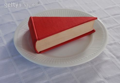 David Malan photograph found at http://www.gettyimages.fr/detail/photo/book-shaped-like-a-slice-of-cake-photo/103324812
