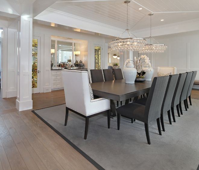 The dining room features a pair of robert abbey bling 6 light chandeliers by circa lighting brandon architects inc