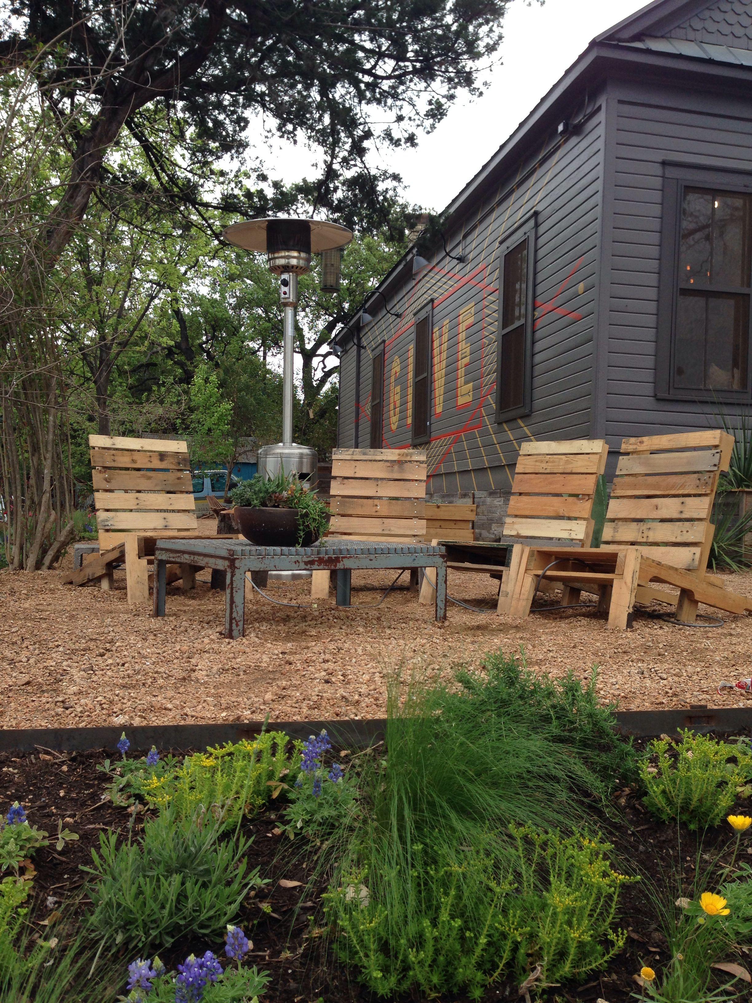 Pallet chairs. Fire pit. Succulents.