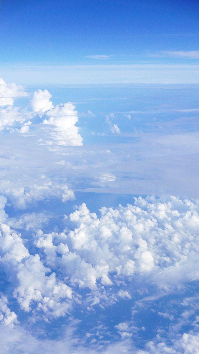 Vertical light blue sky and clouds #cloud #sky #blue #cloudscape #nature