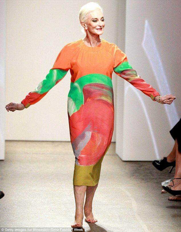 All change: Several hours after making her first catwalk appearance 81-year-old Carmen Dell'Orefice walked for Finnish label Marimekko