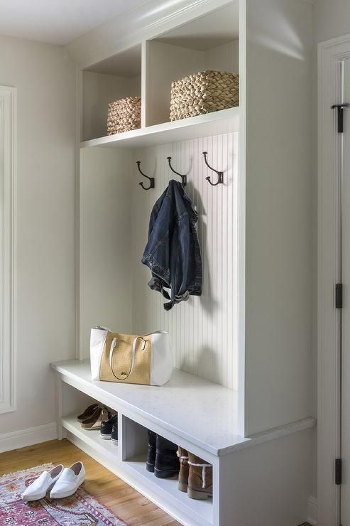 Beautiful Mudroom Features A White Quartz Top Bench Fitted With