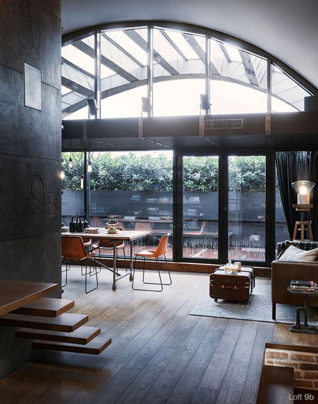 Salon avec une grande baie vitre Esprit