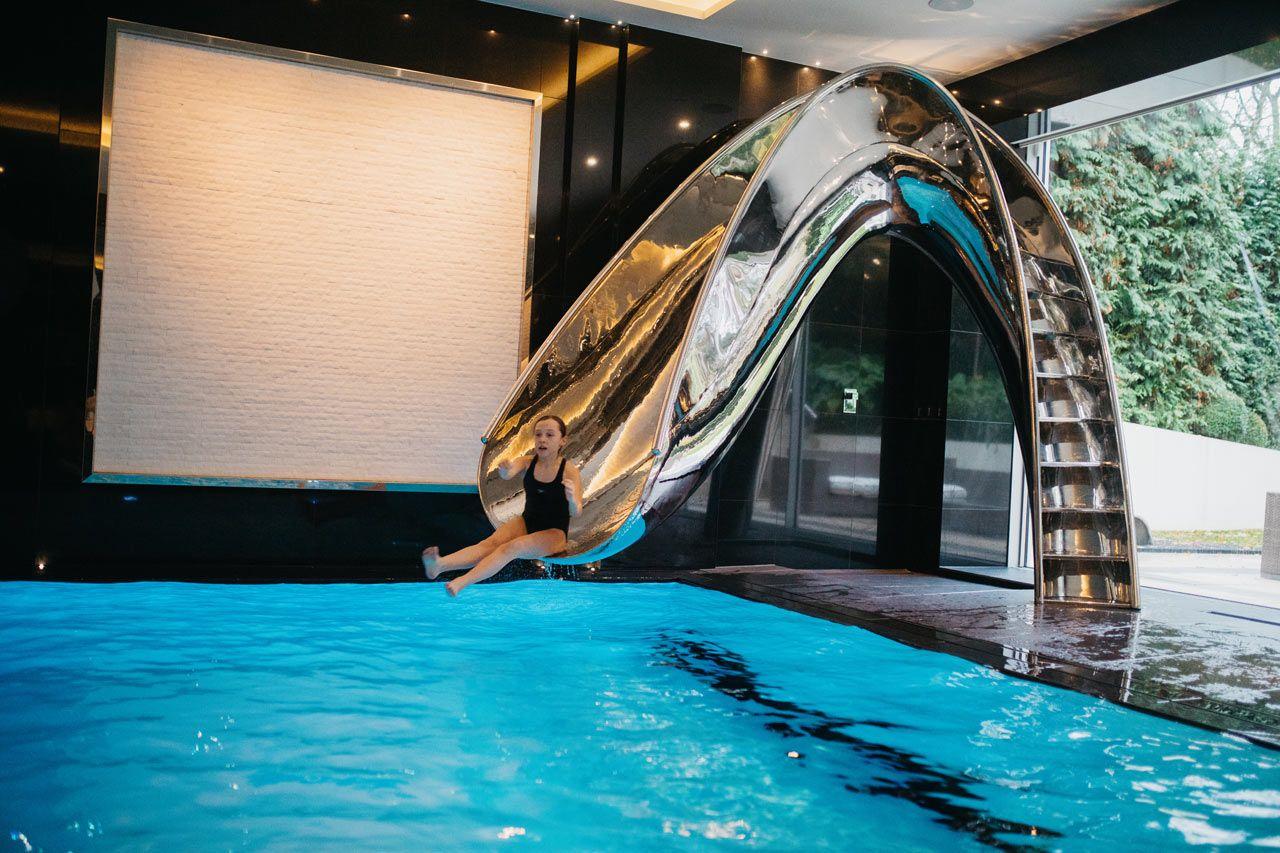 Sleek Sculptural Water Slides For The Modern Pool Swimming Pool Slides Pool Water Features Pool Water Slide