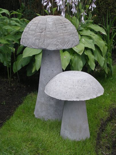DIY concrete mushrooms: Plastic bowl, large paper cup and Pam.
