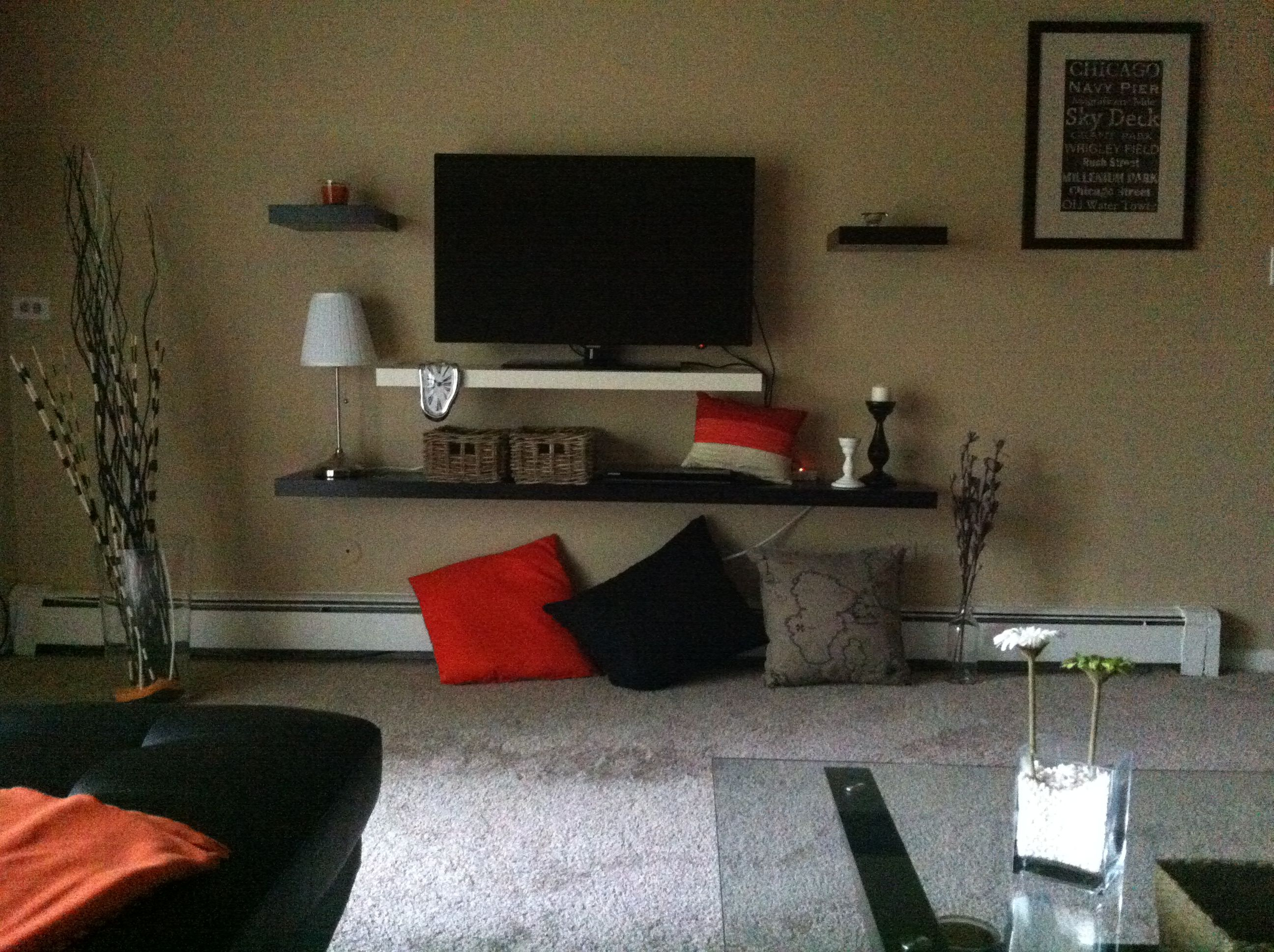 Do it yourself living room TV shelf. No TV stand needed. And it was much cheaper, even with all the accessories!