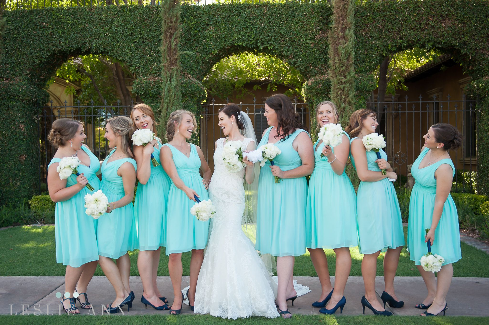 A candid photo of the bride and her bridesmaids. Tiffany blue, v ...
