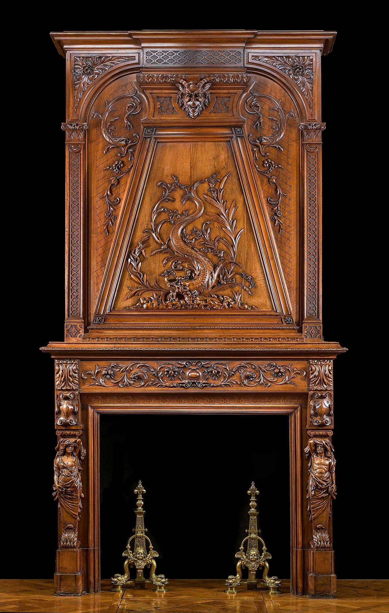 a beautiful tall and elegant walnut wood antique trumeau fireplace