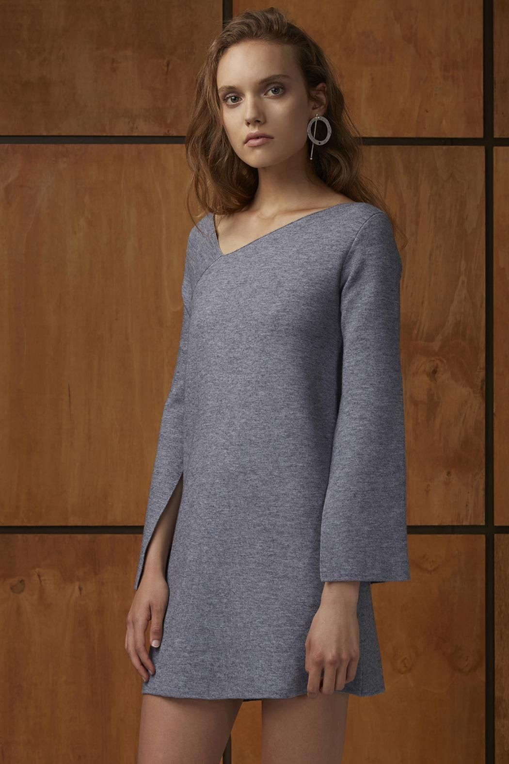 The Break Free Knit Dress is a relaxed fit mini dress with a wide v-neckline, and long flared sleeves with splits in the underarms in a mid-weight knit fabric.   Break Free Knit Dress by C/MEO COLLECTIVE. Clothing - Dresses - Mini Clothing - Dresses - Long Sleeve Sydney, New South Wales, Australia