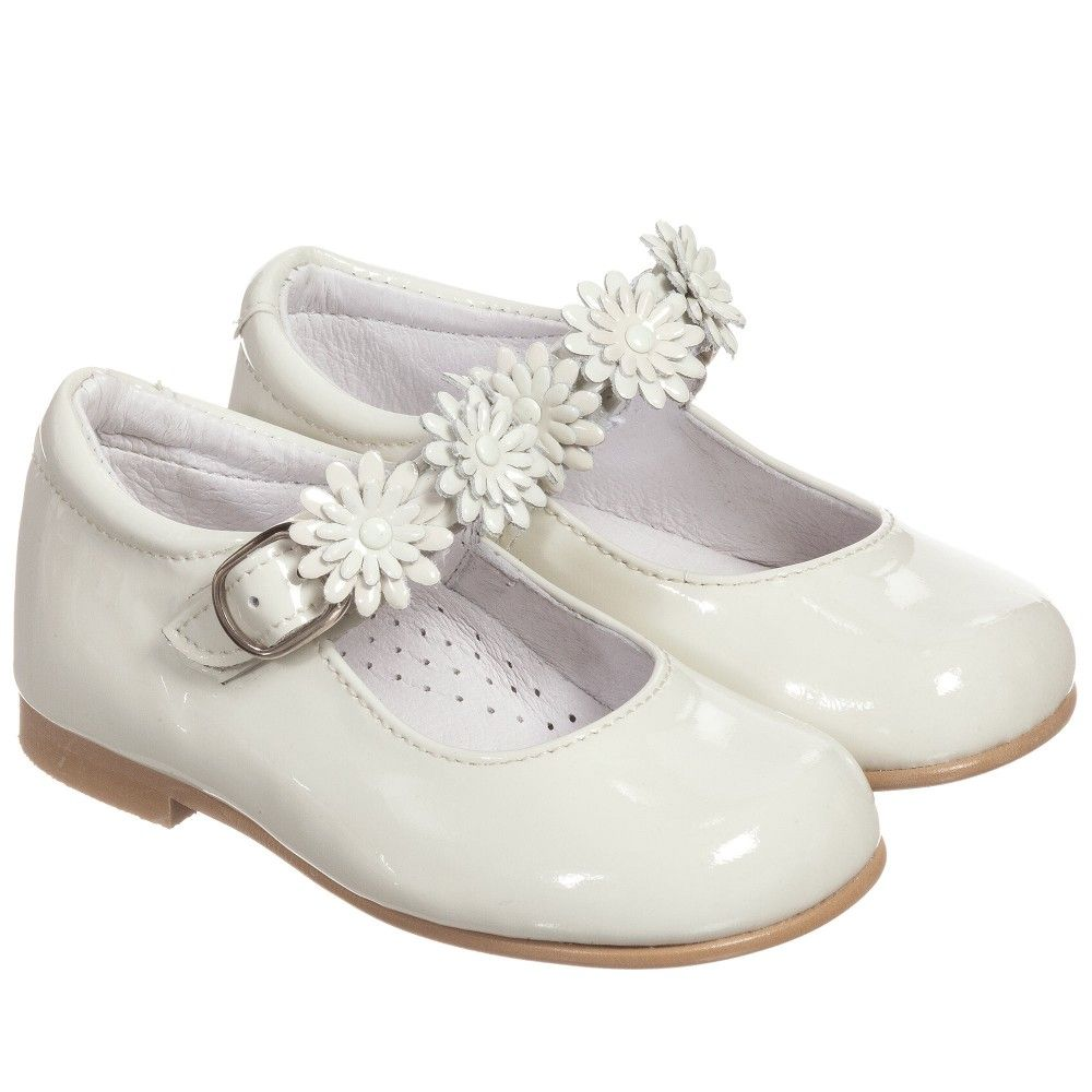 4bae7d9eff3b Girls ivory patent leather shoes by Children s Classics. These smart shoes  are in a Mary Jane style design. They have a leather lining and padded  instep