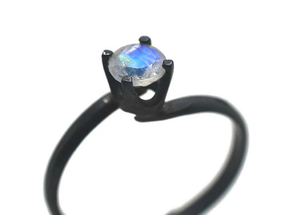 This kin of stone is maybe cooler then diamonds. 5mm Blue Moonstone Ring Minimalist Engagement Ring by fifthheaven, $52.00