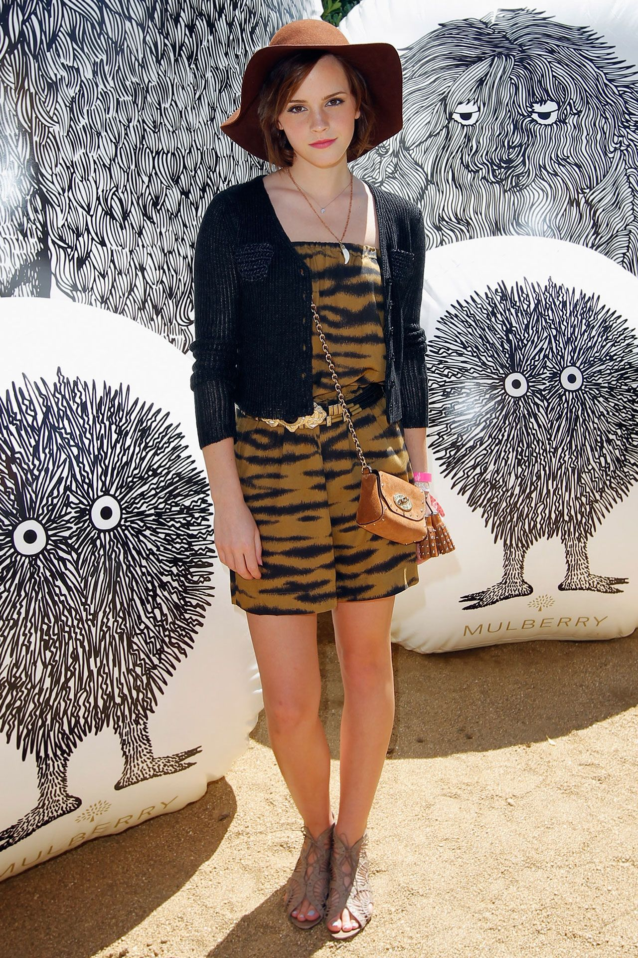 c93aa18ea145 ... Mulberry Lily Mini Bag with Tassels and Opening Ceremony Raffia Pocket  Cardigan. Coachella Celebrities
